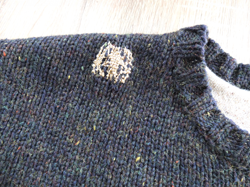 Patched sweater